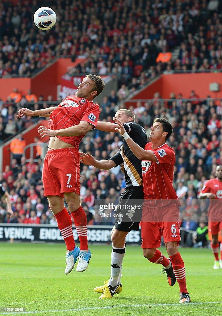 Rickie Lambert of Southampton gets above Brede Hangeland of Fulham and team mate Jose Fonte during the Barclays Premier League match between Southampton and Fulham at St Mary's Stadium on October 7, 2012 in Southampton, England.