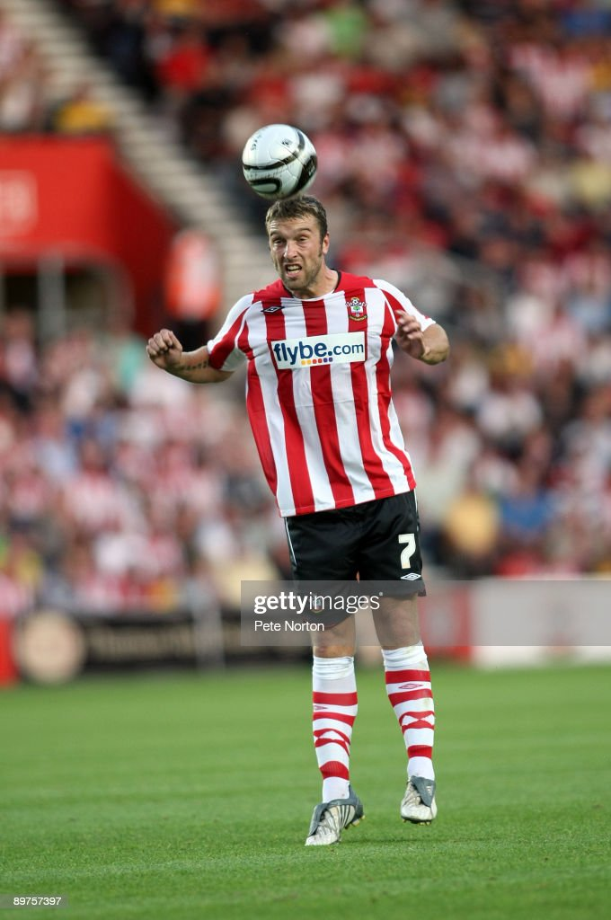 Rickie Lambert of Southampton heads the ball during the Carling Cup Round One Match between Southampton and Northampton Town at St Mary's Stadium on August 11, 2009 in Southampton, England. Southampton won the match 2-0.