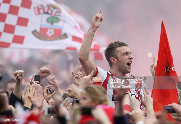 Rickie Lambert of Southampton is carried on home supporters shoulders as he celebrates promotion after his sides 4-0 victory during the npower...