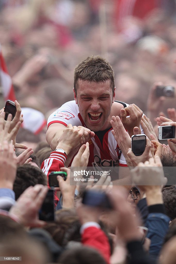 Rickie Lambert of Southampton is carried on home supporters shoulders as he celebrates promotion after his sides 4-0 victory during the npower Championship match between Southampton and Coventry City at St Mary's Stadium on April 28, 2012 in Southampton, England.