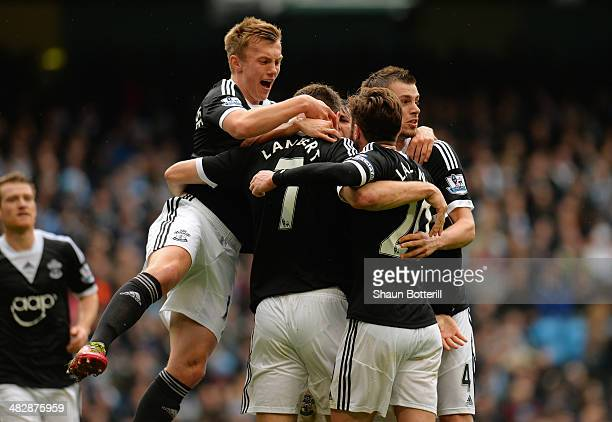 Rickie Lambert of Southampton is congratulated by teammates after scoring a goal from the penalty spot to level the scores at 11 during the Barclays...