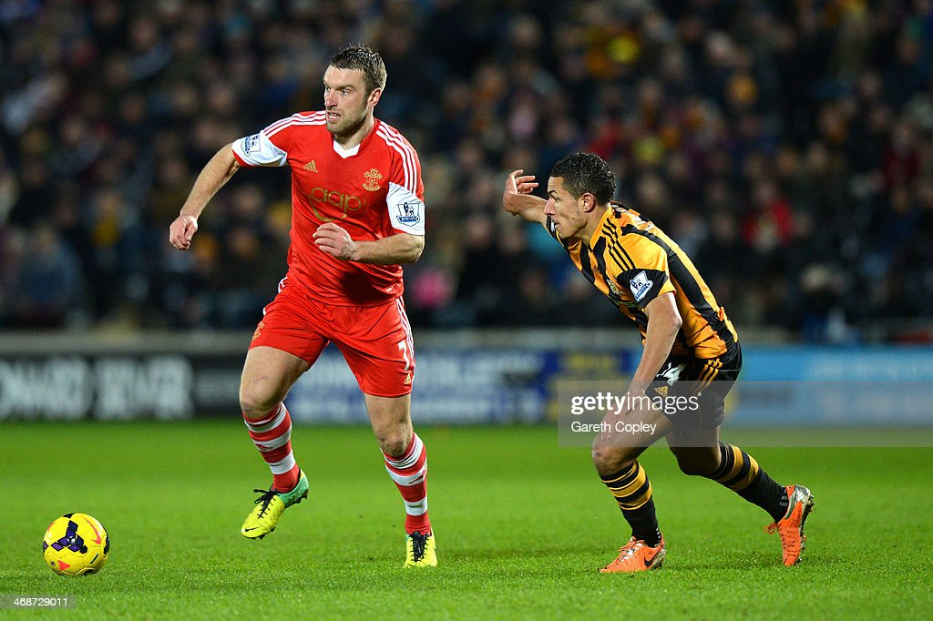 Rickie Lambert of Southampton is marshalled by Jake Livermore of Hull City during the Barclays Premier League match between Hull City and Southampton at the KC Stadium on February 11, 2014 in Hull, England.