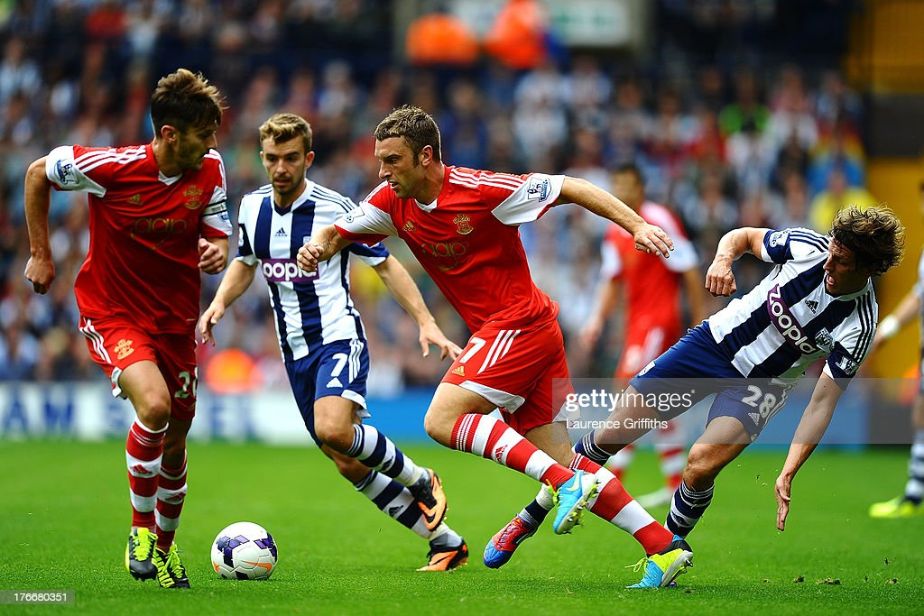Rickie Lambert of Southampton is tackled by Billy Jones of West Bromwich Albion during the Barclays Premier League match between West Bromwich Albion and Southampton at The Hawthorns on August 17, 2013 in West Bromwich, England.