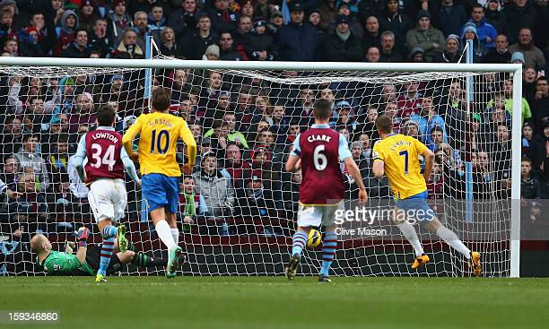 Rickie Lambert of Southampton scores from the penalty spot during the Barclays Premier League match between Aston Villa and Southampton at Villa Park...