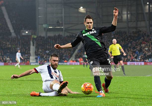 Rickie Lambert of West Bromwich Albion and Philipp Wollscheid of Stoke City compete for the ball during the Barclays Premier League match between...