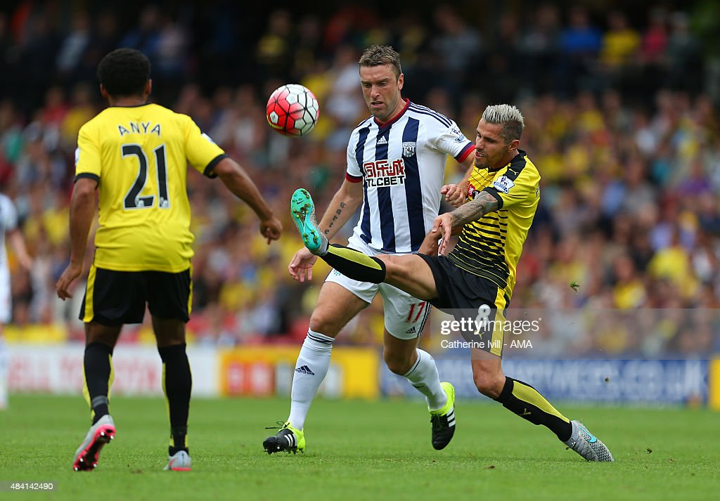 Rickie Lambert of West Bromwich Albion and Valon Behrami of Watford during the Barclays premier League match between Watford and West Bromwich Albion at Vicarage Road on August 15, 2015 in Watford, England.
