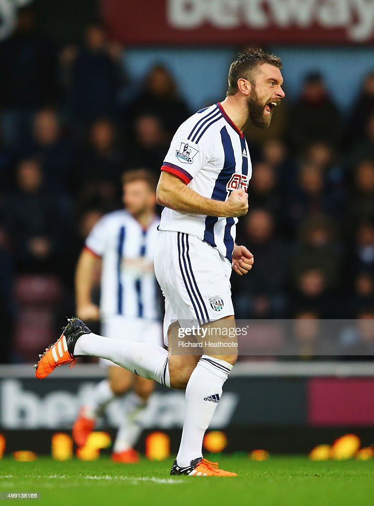 Rickie Lambert of West Bromwich Albion celebrates as his shot deflects off of Winston Reid of West Ham United for their equalising goal during the Barclays Premier League match between West Ham United and West Bromwich Albion at Boleyn Ground on November 29, 2015 in London, England.