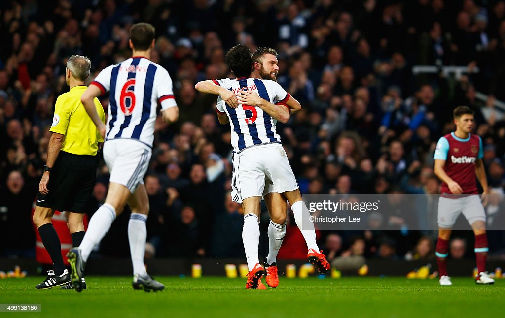 Rickie Lambert of West Bromwich Albion celebrates with Claudio Yacob (5) as his shot deflects off of Winston Reid of West Ham United for their equalising goal during the Barclays Premier League match between West Ham United and West Bromwich Albion at Boleyn Ground on November 29, 2015 in London, England.