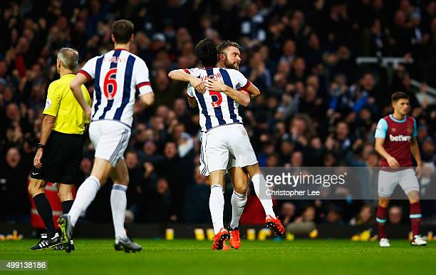 Rickie Lambert of West Bromwich Albion celebrates with Claudio Yacob as his shot deflects off of Winston Reid of West Ham United for their equalising...