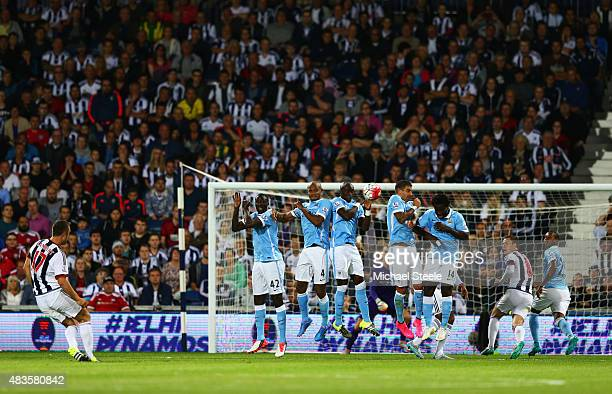 Rickie Lambert of West Bromwich Albion shoots past the Manchester City wall from a free kick during the Barclays Premier League match between West...