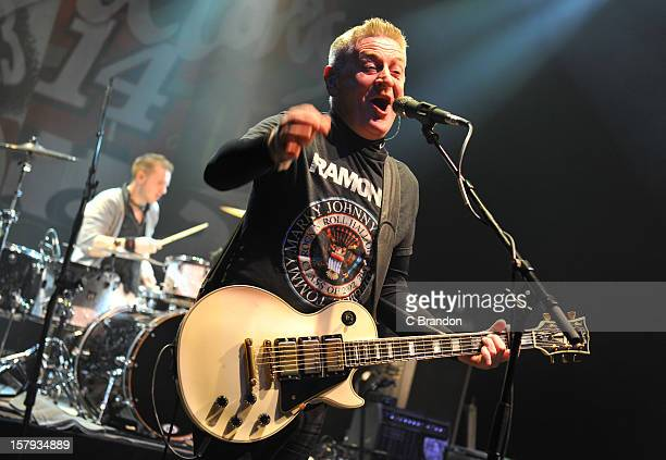 Rickie O'Neill and Davy Carton of The Saw Doctors perform on stage at O2 Shepherd's Bush Empire on December 7 2012 in London England