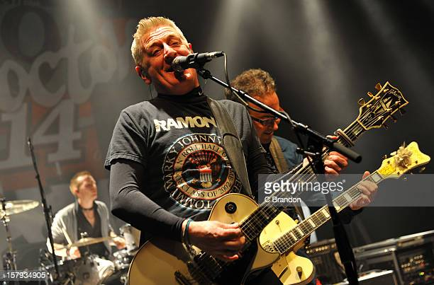 Rickie O'Neill Davy Carton and Leo Moran of The Saw Doctors perform on stage at O2 Shepherd's Bush Empire on December 7 2012 in London England