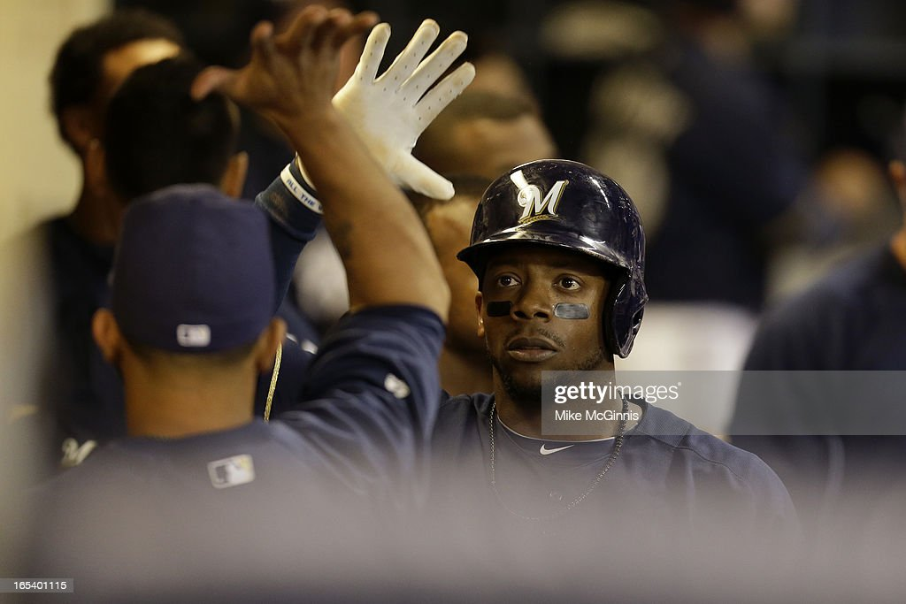 Rickie Weeks #23 of the Milwaukee Brewers celebrates in the dugout after scoring on a double by Ryan Braun in the bottom of the seventh inning against the Colorado Rockies at Miller Park on April 3, 2013 in Milwaukee, Wisconsin.