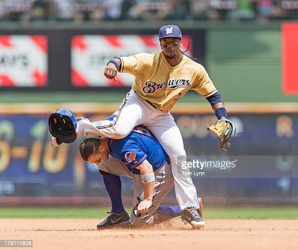 Rickie Weeks of the Milwaukee Brewers gets the force out on David Wright of the New York Mets while turning the double play in the fourth inning at...