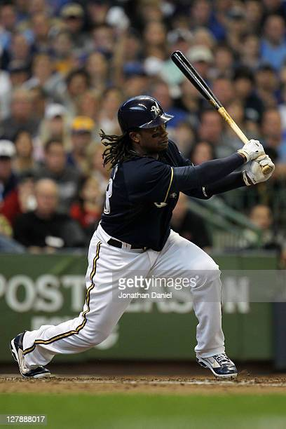 Rickie Weeks of the Milwaukee Brewers hits an RBI triple in the third inning of Game Two of the National League Division Series against the Arizona...