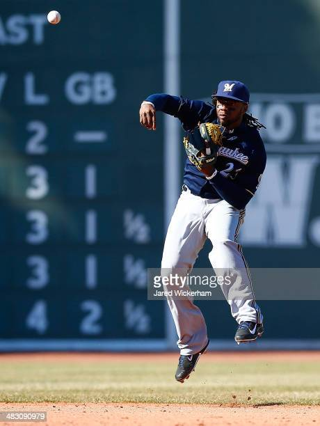 Rickie Weeks of the Milwaukee Brewers jumps and throws to first base in the 7th inning against the Boston Red Sox during the game at Fenway Park on...