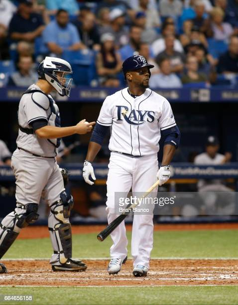 Rickie Weeks of the Tampa Bay Rays reacts after striking out swinging with the bases loaded in front of catcher Gary Sanchez of the New York Yankees...