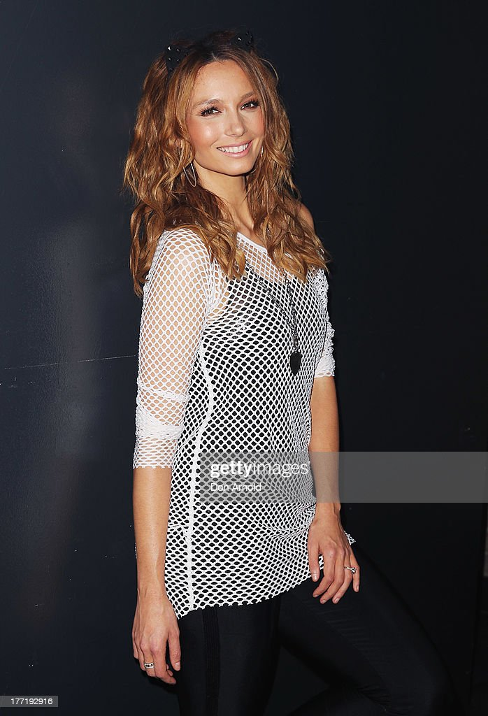Ricki-Lee Coulter poses at the launch of Ricky-Lee's collection for Cotton On Body at Simmer On The Bay, Hickson Road, Dawes Point on August 22, 2013 in Sydney, Australia.