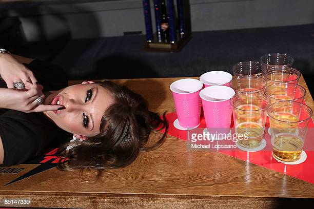 Rick's Cabaret girl films Howard TV On Demand's 'Strip Beer Pong' at Sullivan Hall on February 27 2009 in New York City