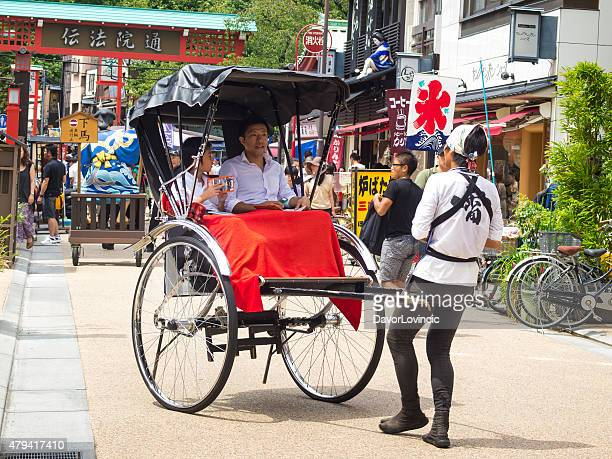 ricksha ride at the street in asakusa tokyo - rickshaw stock photos and pictures