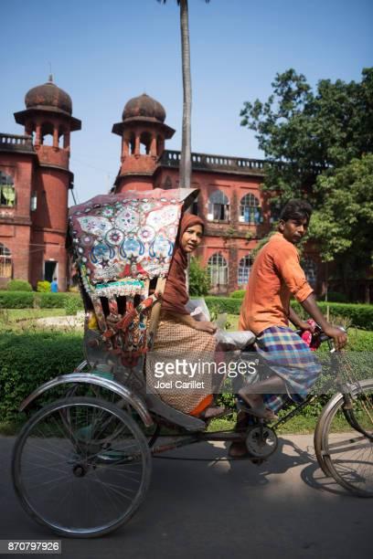 rickshaw at university of dhaka, bangladesh - dhaka university stock photos and pictures