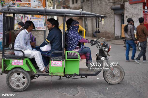 Rickshaw driver Afsana poses for photographs at Seelampur on February 5 2018 in New Delhi India Although being an erickshaw driver for the past 3...