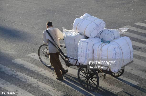 Rickshaw driver dragging cycle rickshaw in Jaipur at Rajasthan, India