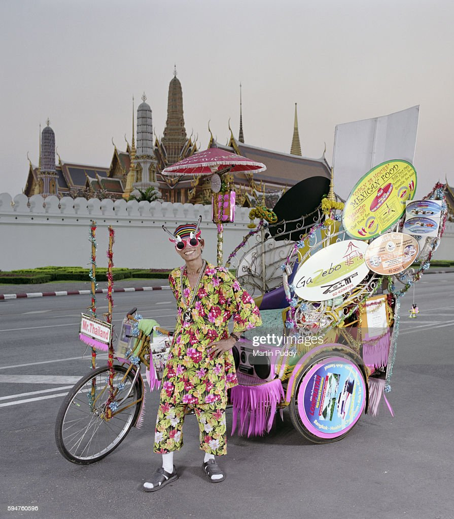 Rickshaw driver in front of the Grand Palace : Stock Photo