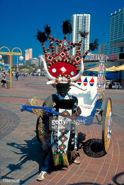 A rickshaw driver on the promenade of Durban's Golden Mile on the Indian Ocean Kwazulu Natal South Africa