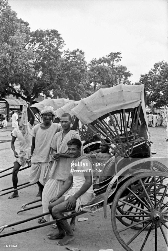 Rickshaw drivers posing on a street. Kolkata, 1962