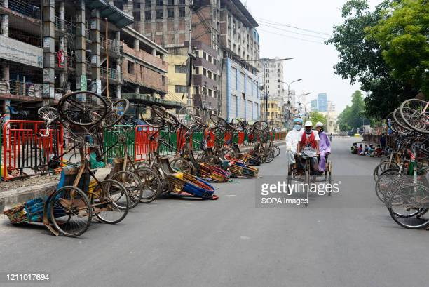 Rickshaw puller carries passengers during a nationwide lockdown. Due to the COVID-19 pandemic, Bangladesh Government restricted all kinds of...