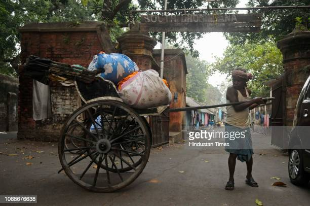 A rickshaw puller carries washed clothes for delivery to the respective customers from 116yearold South Dhobikhana on November 25 2018 in Kolkata...