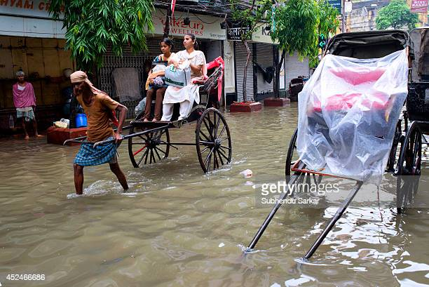 A rickshaw puller in a waterlogged street in Kolkata Heavy rains resulted in water logging in many parts of Kolkata India with daily life badly...