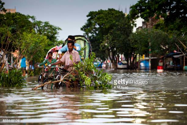 AGRABAD DHAKA CHITTAGONG BANGLADESH Rickshaw puller stuck in a flooded street in Chittagong Chittagong city is facing unprecedented flooding this...
