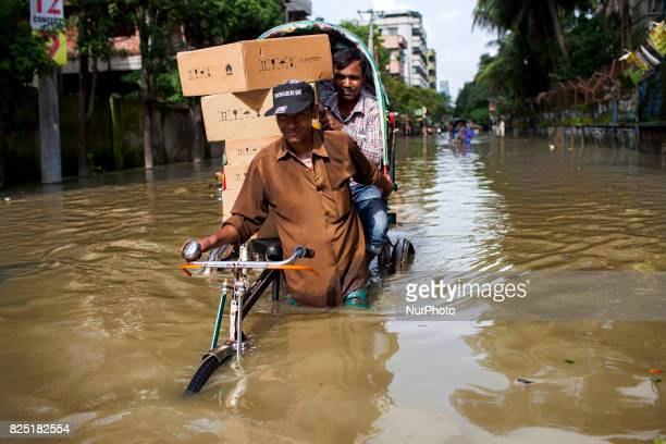 Rickshaw puller transport passenger in water logging area July 26 2017 Chittagong Bangladesh Every day the Chittagong city is facing unmatched...