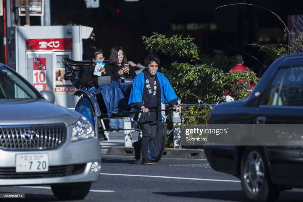 A rickshaw puller transports customers during a campaign event for Ant Financial Services Group's Alipay, an affiliate of Alibaba Group Holding Ltd., in Tokyo, Japan, on Saturday, Dec. 9, 2017. Ant Financial and its strategic partners outside China should be able to nearly double users of their payments systems in coming years, Ant's overseas operations president Douglas Feagin said on Nov. 14. Photographer: Shiho Fukada/Bloomberg via Getty Images