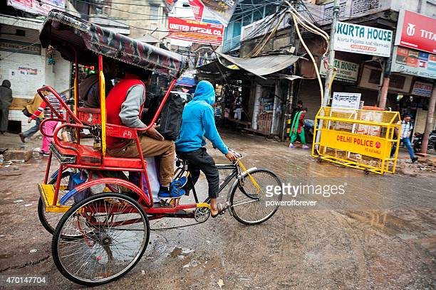 Rickshaw Transporting People in Old Delhi, India
