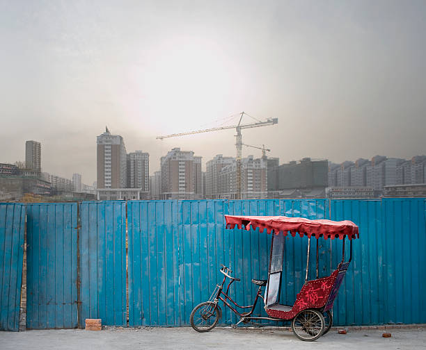 Rickshaw with new construction in background (digital composite)