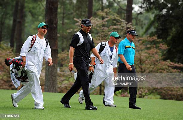 Ricky Barnes and Jason Bohn of the US walk on the second hole during the second round of the Masters golf tournament at Augusta National Golf Club on...