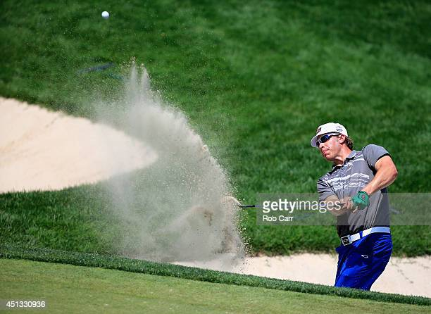 Ricky Barnes of the United States hits from the sand trap on the second hole during the second round of the Quicken Loans National at Congressional...