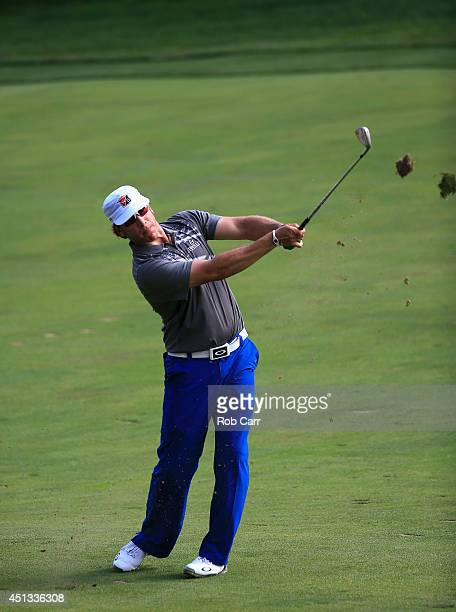 Ricky Barnes of the United States watches his approach shot on the eighth hole during the second round of the Quicken Loans National at Congressional...