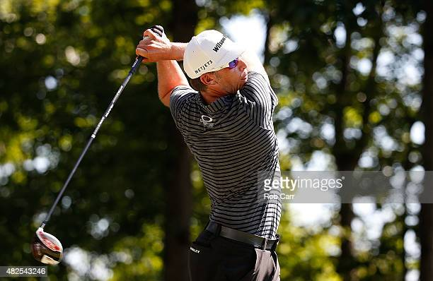 Ricky Barnes watches his tee shot on the 15th hole during the second round of the Quicken Loans National at the Robert Trent Jones Golf Club on July...