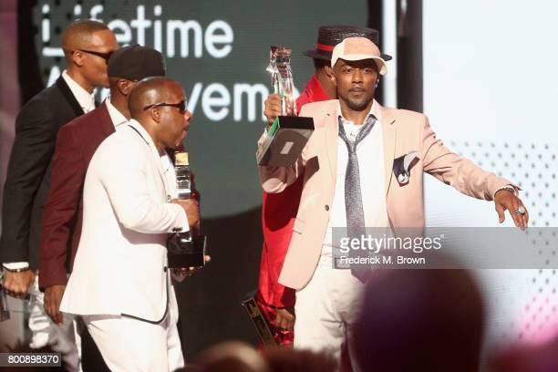 Ricky Bell Bobby Brown Johnny Gill Ronnie DeVoe Michael Bivins and Ralph Tresvant of New Edition accept the Lifetime Achievement Award onstage at...