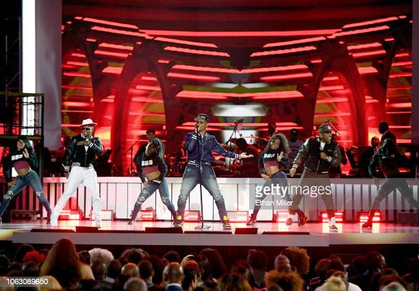 Ricky Bell Ronnie DeVoe and Michael Bivins of Bell Biv DeVoe perform onstage during the 2018 Soul Train Awards presented by BET at the Orleans Arena...