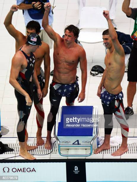 Ricky Berens, Peter Vanderkaay, Ryan Lochte and Michael Phelps of the United States celebrate finishing first in the Men's 4 x 200m Freestyle Relay...