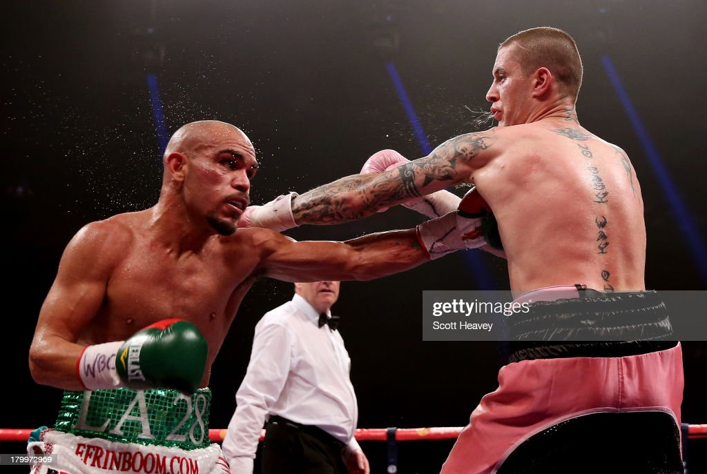 Ricky Burns (R) in action with Raymundo Beltran during their WBO World Lightweight Title bout at SECC on September 7, 2013 in Glasgow, Scotland.