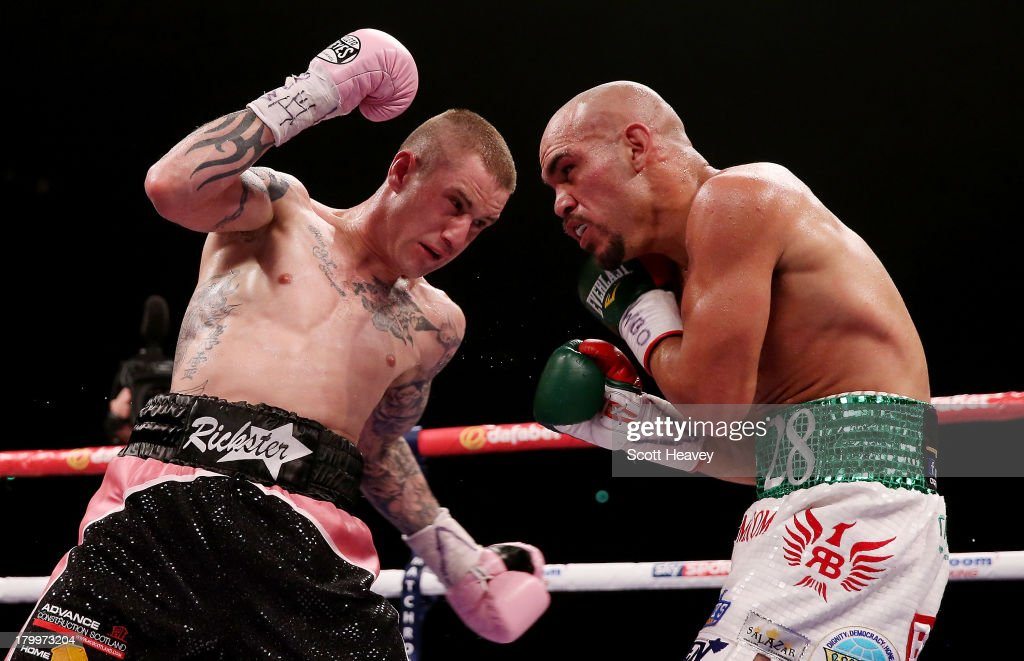 Ricky Burns in action with Raymundo Beltran during their WBO World Lightweight Title bout at SECC on September 7, 2013 in Glasgow, Scotland.