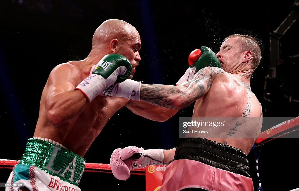 Ricky Burns is caught by Raymundo Beltran during their WBO World Lightweight Title bout at SECC on September 7, 2013 in Glasgow, Scotland.