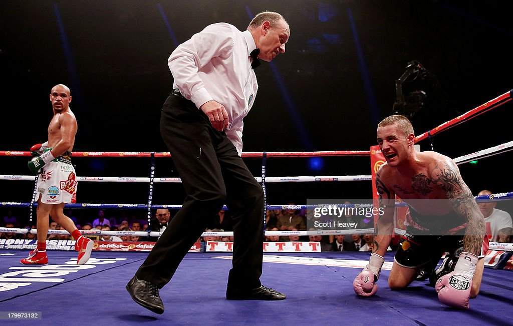 Ricky Burns is given a count after being knocked down by Raymundo Beltran during their WBO World Lightweight Title bout at SECC on September 7, 2013 in Glasgow, Scotland.