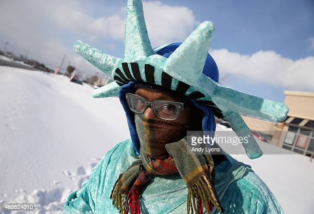 Ricky Carter waves to cars as he stands and advertises for a Liberty Tax Preperation in the snow and cold on February 18 2015 in Louisville Kentucky...